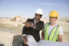 Engineer And Worker In Discussion At Site Stock Images