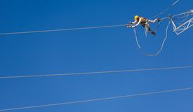 Engineer worker on energy wire Royalty Free Stock Photo