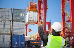 Engineer/worker/freight forwarder working on container terminal port/harbour stock images