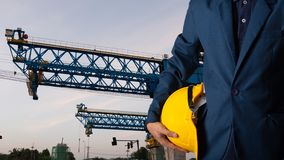 Engineer or worker hold yellow helmet for workers security stock photo