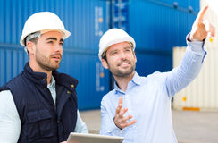 Engineer and worker speaking about work on the dock Royalty Free Stock Photos