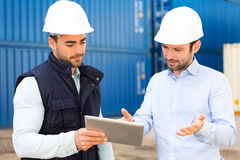 Engineer and worker speaking about work on the dock Royalty Free Stock Photo