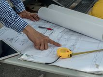 Engineer and workers discussing project of new building. architects Asian people on construction site check documents and business. Workflow stock photo