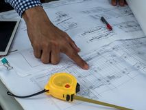 Engineer and workers discussing project of new building. architects Asian people on construction site check documents and business. Workflow stock image