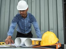 Engineer and workers discussing project of new building. architects Asian people on construction site check documents and business. Workflow royalty free stock photography