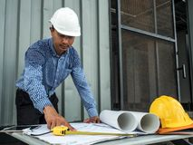 Engineer and workers discussing project of new building. architects Asian people on construction site check documents and business. Workflow royalty free stock image