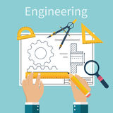 Engineer working on blueprint. Engineering drawing, technical scheme. Sketching gear, project. Engineer Designer in project. Drawings for production Royalty Free Stock Photo