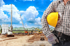 Engineer working in building construction site against blue sky Royalty Free Stock Photography