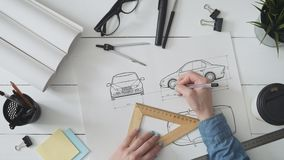 Engineer working on a car design sketch. Stock footage stock video