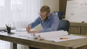 Engineer working on a car design sketch. Stock footage stock video footage