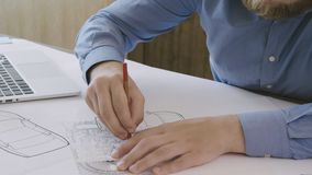 Engineer working on a car design sketch. Stock footage stock footage
