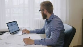 Engineer working on a car design sketch using his laptop computer. Engineer working on a car design sketch stock footage stock video
