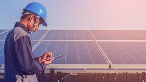 Engineer working on checking and maintenance structure and solar. Panel and find problem to operate at green energy solar power plant royalty free stock photo