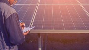Engineer working on checking and maintenance structure and solar. Panel and find problem to operate at green energy solar power plant royalty free stock image