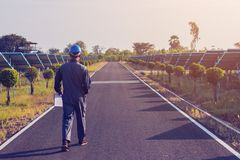 Engineer working on checking and maintenance structure and solar. Panel and find problem to operate at green energy solar power plant stock images