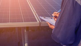 Engineer working on checking and maintenance structure and solar. Panel and find problem to operate at green energy solar power plant stock photos