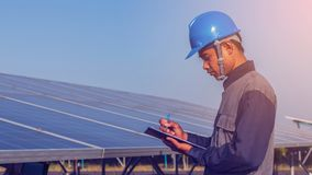 Engineer working on checking and maintenance structure and solar. Panel and find problem to operate at green energy solar power plant stock photography
