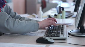 Engineer is Working on computer, typing on keyboard. stock footage