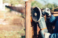 engineer working and cutting metal reinforced steel bars using angle grinder Stock Photo