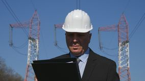 Engineer Working in Energy Industry Check Maintenance File stock photo