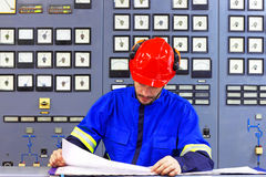 Engineer working in the industrial interior Stock Image