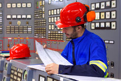 Engineer working in the industrial interior Royalty Free Stock Photos