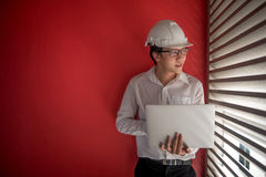 Engineer working with laptop in red building space Royalty Free Stock Photos