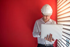 Engineer working with laptop in red building space Royalty Free Stock Image