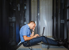 IT Engineer working on a laptop Royalty Free Stock Photos