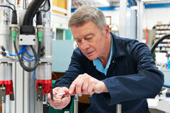 Engineer Working On Machine In Factory royalty free stock photo