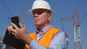 Engineer Working in Maintenance Text Using Cell Phone. Image with Engineer Working in Maintenance Text Using Cell Phone royalty free stock photos
