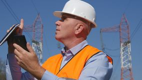 Engineer Working in Maintenance Using Cell Phone Communication royalty free stock photography