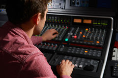 Engineer Working At Mixing Desk In Recording Studio Royalty Free Stock Image