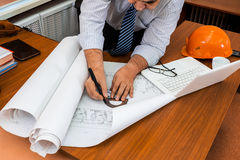 Engineer working in the office with the drawings Stock Photo