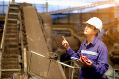 Engineer working in the production line process plant and thinking before starting work. Industrial concept royalty free stock photo