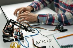 Engineer working on robotics automation project royalty free stock image