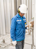 Engineer working with safety ear muffs helmet and gloves for ind Stock Photo