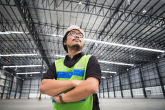 Engineer working and standing in new warehouse Stock Images