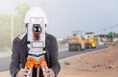 Engineer working with survey equipment theodolite with road unde Stock Image