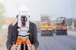 Engineer working with survey equipment theodolite with road unde Stock Photo