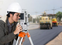 Engineer working with survey equipment theodolite with road unde Stock Images