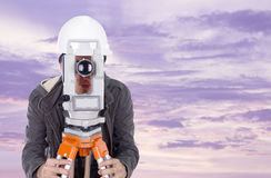 Engineer working with survey equipment theodolite at sunset Royalty Free Stock Images