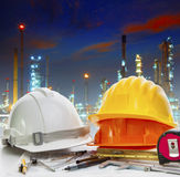 Engineer working table against oil refinery industry plant use f Royalty Free Stock Photos