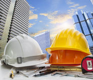 Engineer working table against sky scrapper in urban scene use f Stock Photos