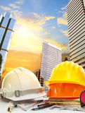Engineer working table against sky scrapper in urban scene use f. Or land development and architecture occupation theme Royalty Free Stock Photos