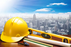 Engineer working table plan and blueprints at building construct Stock Image