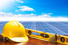 Engineer working table plan at solar energy power plant against. Beautiful sky with in concept ecology Stock Photography