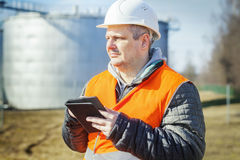 Engineer working with tablet PC in the factory Royalty Free Stock Photos