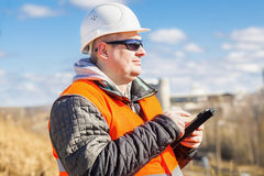 Engineer working with tablet PC at outdoors Stock Photography