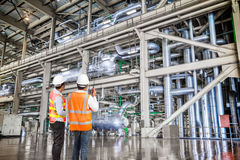 Engineer working in a thermal power plant with talking on radio Royalty Free Stock Photography